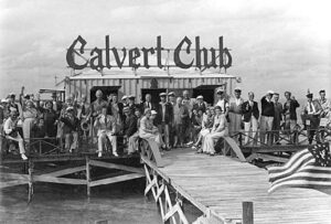 The Calvert Club was popular in the early days of Miami's Stiltsville. This photo shows a group of revelers enjoying a day at the club in the middle of Biscayne Bay.