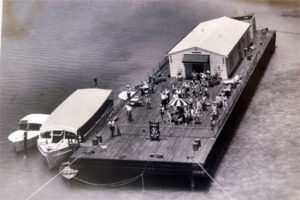 """An early photo of a Stiltsville """"home"""" actually constructed on a barge. One of many social spots in Miami during the 1950's."""